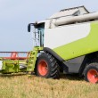 Working harvesting combine in field — Stock Photo #5365740