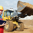 Smiling Builder inspector at construction area - Foto Stock