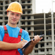 Builder satisfied inspector at construction area - Stock Photo