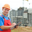 Stock Photo: Smiling Builder inspector at construction area