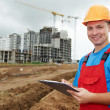 Smiling Builder inspector at construction area - Stock Photo
