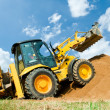 Excavator Loader with backhoe works - Stock Photo