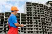 Builder and building under construction — Stock Photo