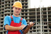 Builder satisfied inspector at construction area — Stock Photo