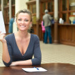 Young woman holding a paper in hand — Stock Photo #4066426
