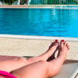 Stock Photo: Legs of young unrecognizable woman in a bikini