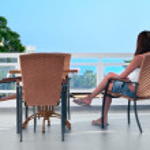 Beautiful woman sitting in balcony — Stock Photo