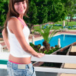 Young beautiful womstanding on balcony of hotel — Stok Fotoğraf #4251435