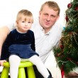 Royalty-Free Stock Photo: Dad and little girl at Cristmas time.