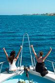 Two women on yacht on stern — Zdjęcie stockowe