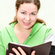 Beautiful girl holding ebook in hands — Stock Photo #4630719