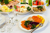Plate with smoked fish on table, cutlery for dinner, — Stock Photo