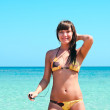 Young sexy girl standing near the sea — Stock Photo