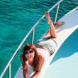 Stock Photo: Young beautiful girl laying on yacht