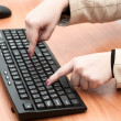 Women's hands clumsily printed on a black keyboard — Stock Photo #5169011