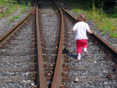 Girl at Railroad tracks — ストック写真