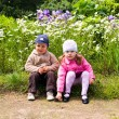 Little boy and girl in park - Stock Photo