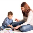 Young mother and a 3 years old son painting — Stock Photo