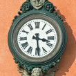 Stock Photo: Wall mounted clock