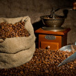Постер, плакат: Sack of coffee beans coffee grinder and metal scoop still life