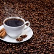 Stock Photo: White cup of hot coffee on coffee beans