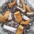 Stock Photo: Butts from cigarettes in ashtray