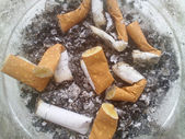 Butts from cigarettes in ashtray — Stock Photo