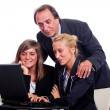 Royalty-Free Stock Photo: Senior Businessman with Young Businesswoman Look Computer
