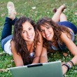 Two Young Woman With Laptop PC at Park — Stock Photo