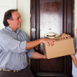 Man Receive a Box from Young Woman with Christmas Hat — Stock Photo