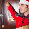 Delivery Boy with Christmas Hat Knock at Door — Stock Photo #4208737
