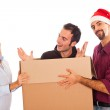 Delivery Boy with Christmas Hat, Present for Woman — Stock Photo #4225541