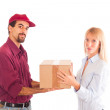 Delivery Boy with Box for Young Woman — Stock Photo #4279906