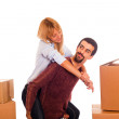 Young Couple on Moving - Man Piggybacking Woman — Stock Photo #4335929