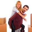 Young Couple on Moving - Man Piggybacking Woman — Stock Photo #4335938