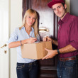 Delivery Boy with Box for Young Woman — Stock Photo