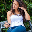 Young Woman Listening Music at Park — Stock Photo