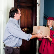 Female Courier Deliver a Box — Stock Photo #4459101