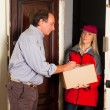 Female Courier Deliver a Box - Stock Photo