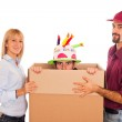 Delivery Boy with Surprise for Young Woman on Birthday — Stock Photo #4459170