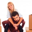 Young Couple on Moving - Man Piggybacking Woman — Stock Photo #4459256