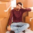 Stressed Young Man on Moving Swamped with Boxes — Stock Photo