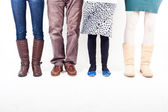Legs of with Different Casual Clothes — Stock Photo