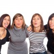 Four Happy Girls Grimacing with Tongue Out — Stock Photo