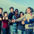 Happy College Students with Thumbs Up — Stock Photo #4634481