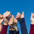 Multiracial Thumbs Up Against Blue Sky — Stock Photo