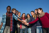 Happy College Students with Hands on Stack — Stock Photo