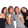 Four Happy Girls Grimacing and Making Hand Sign — Stock Photo #4644314