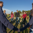 Stock Photo: Multiracial Young Holding Hands in a Circle