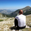 Person Relax on Top of a Mountain Against Great Panorama — Stock Photo #4799235